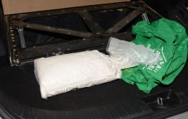 Hidden trap compartment in car trunk  was found by police crammed with drugs, weapon, cash